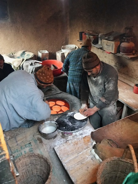 A Kashmiri baker kneading morning bread (tsot, tchot) next to the tandoor oven early in the morning