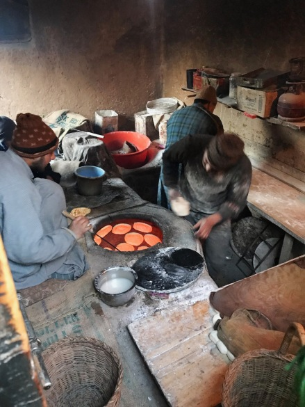 A Kashmiri baker getting ready to stick a piece of morning bread (tsot, tchot) to the inside wall of his tandoor oven