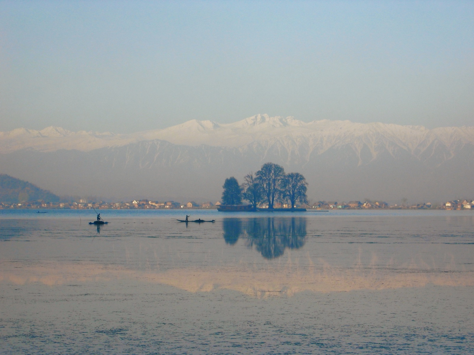 early morning view in April 2006 across Dal Lake, Srinagar, Kashmir to the snow covered Pir Panjal Himalayan mountains